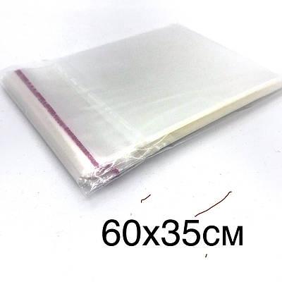 Поліпропіленовий пакет з клейкою стрічкою 60*35см, в закритому виді 57*35см.