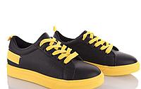 Мягкие и удобные женские кеды черные с желтой шнуровкой