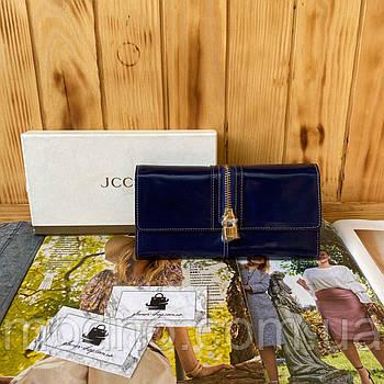Жіночий шкіряний гаманець на кнопці синього кольору JCCS