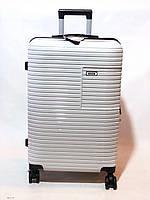 Качественный дорожный чемодан на колесах
