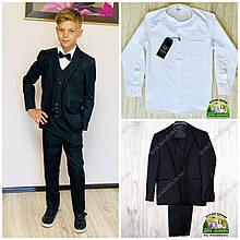 Черный костюм для мальчика: пиджак, жилет и брюки