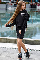 Стильный костюм юбкой на девочку черный