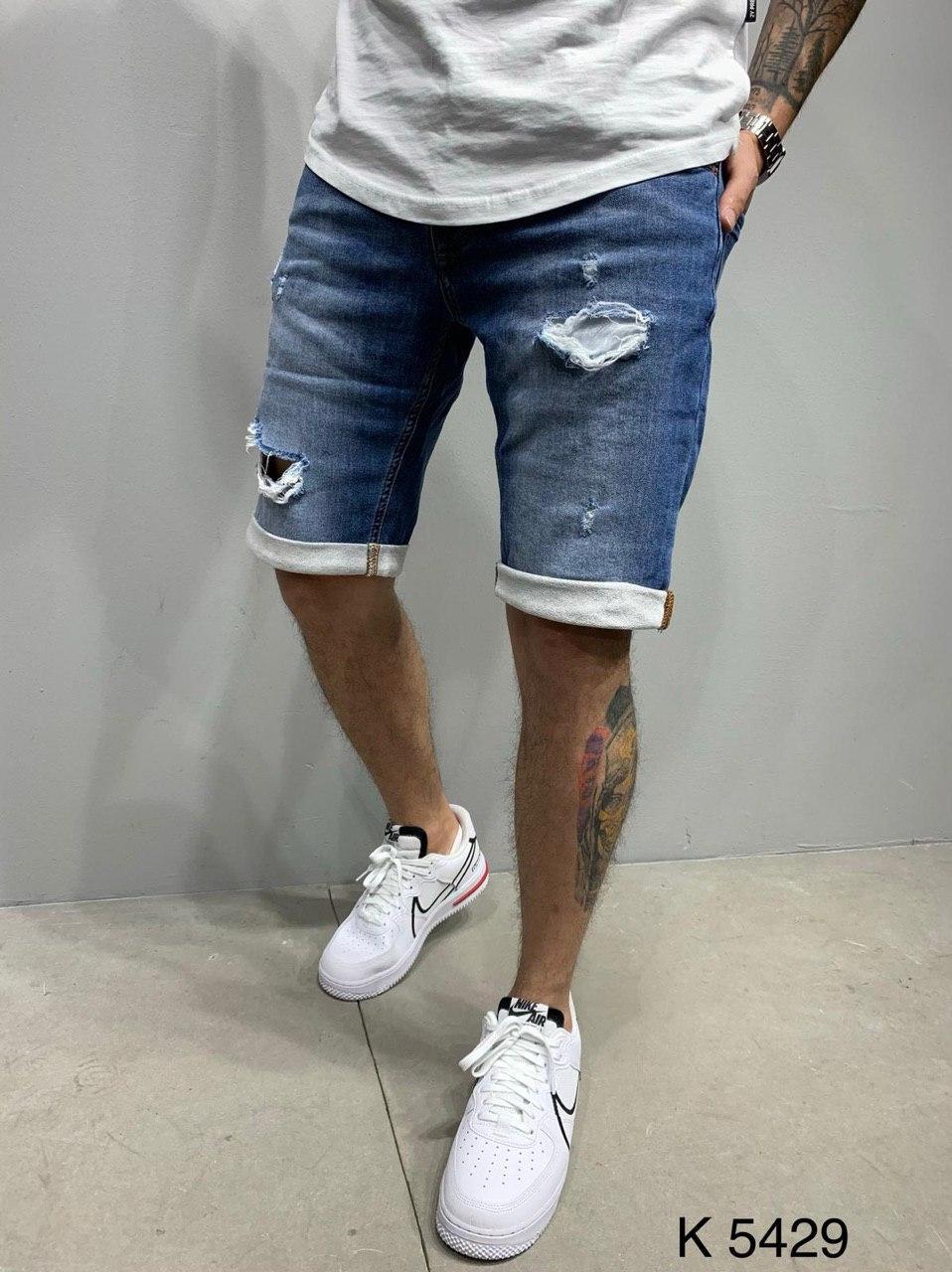 Чоловічі джинсові шорти сині рвані з підворотом