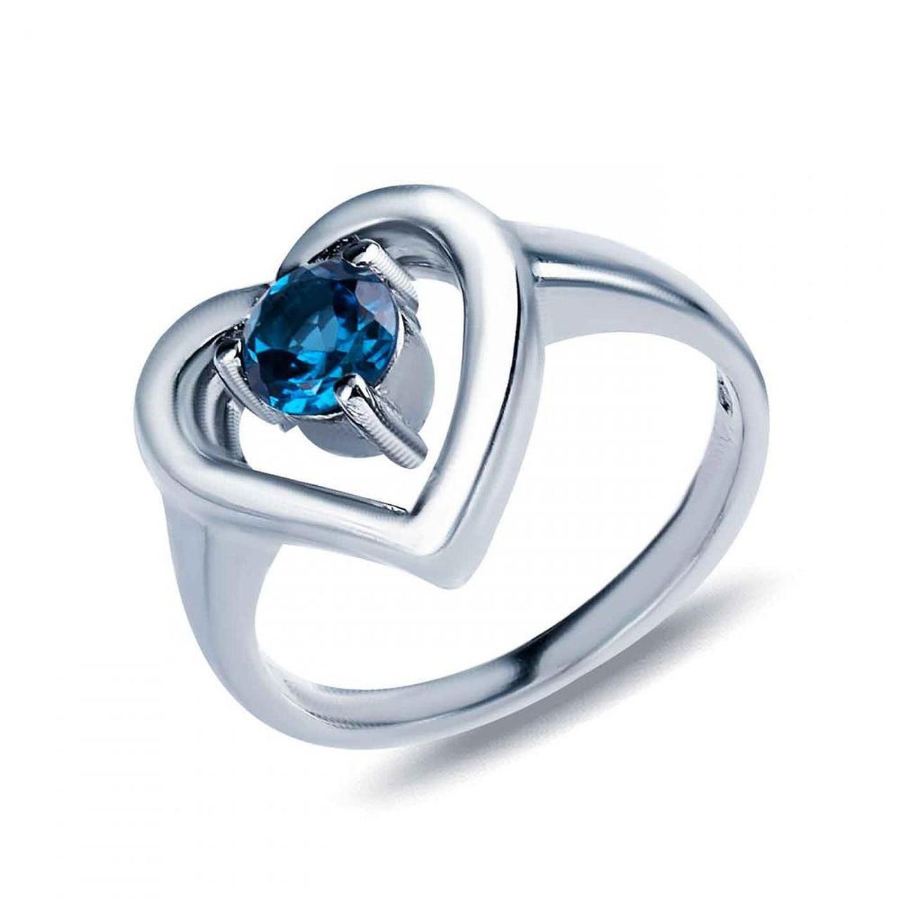Серебряное кольцо с топазом, размер 15.5 (1313776)