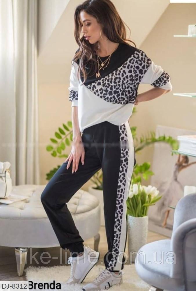 Женский стильный спортивный костюм с леопардовыми вставками