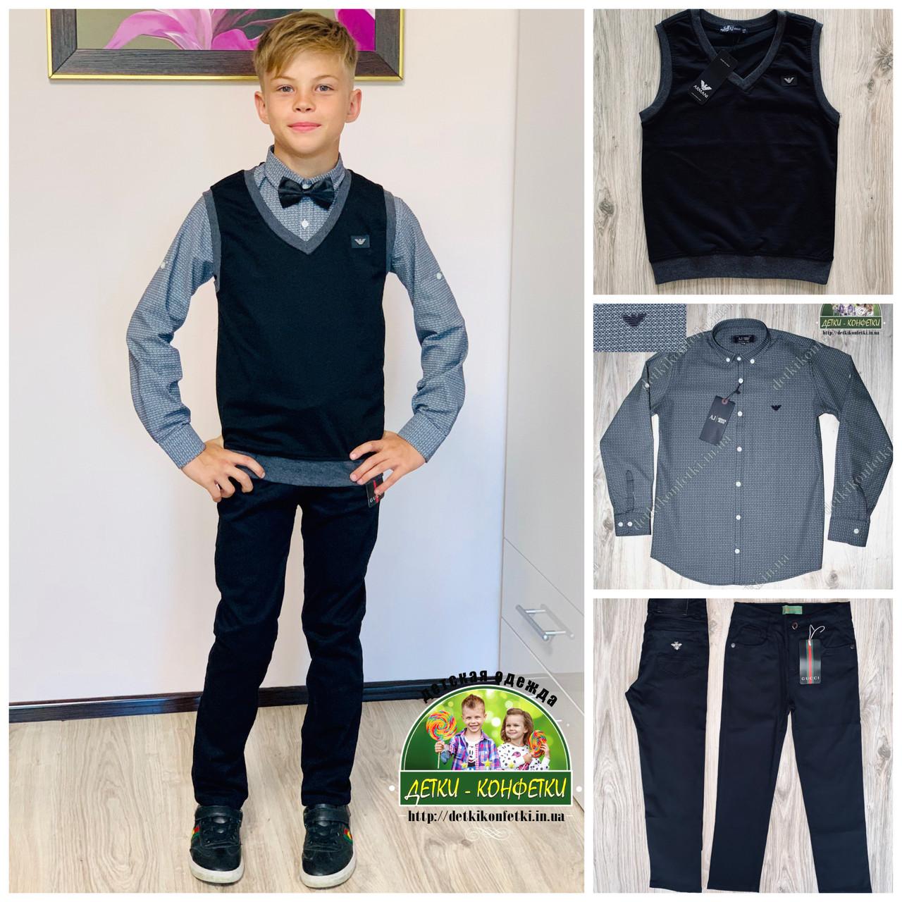 Элегантный костюм для мальчика: рубашка, брюки и жилетка