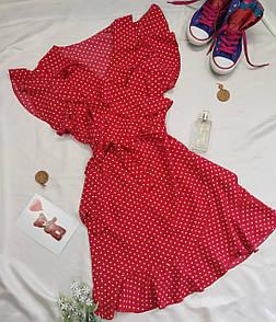 Жіноча червона сукня в горошок з рюшами