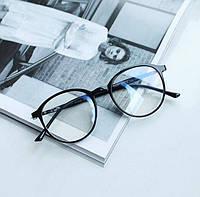 Іміджеві овальні окуляри унісекс в чорній оправі