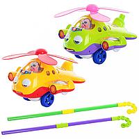 КАТАЛКА 117136 R/0301 на палке, вертолёт, звук, закрывает глазки, двигает языком, пропеллер вращается, 2 цвета.