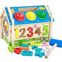 Развивающая деревянная игрушка домик с молоточком. Для самых маленьких.