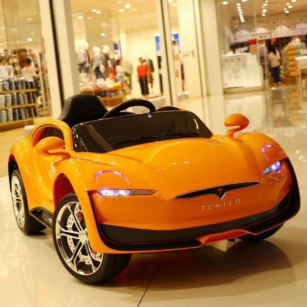 Дитячий електромобіль на акумуляторі Tesla T-7636 помаранчевий. Машина на пульті Тесла