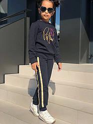 Штани з лампасами для дівчинки