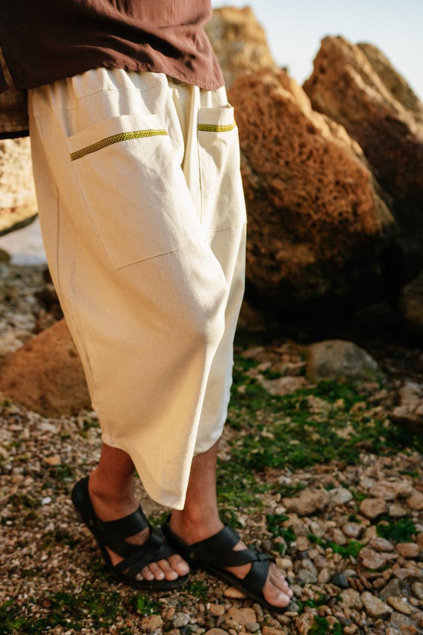 Стильные удобные свободные мужские штаны  бежевого цвета.