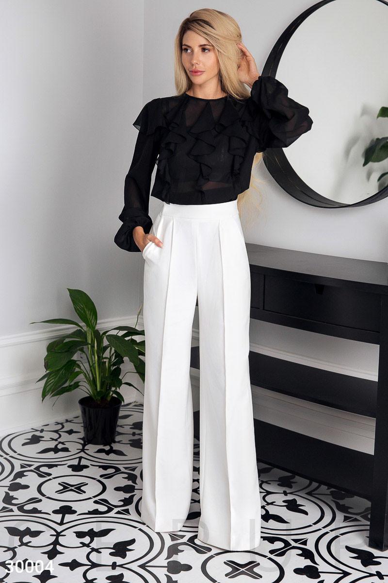 Довгі розкльошені штани білі