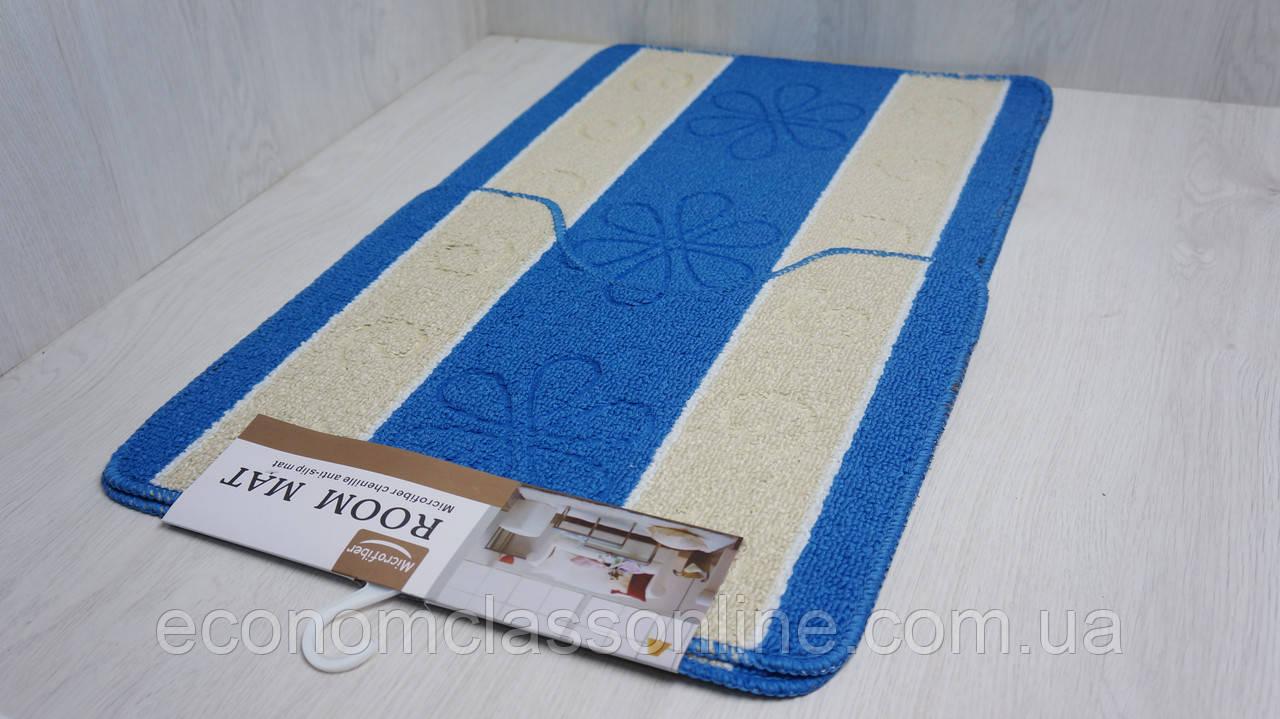 Набір підлогових килимків.