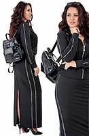 Трикотажный женский костюм с кофточкой на молнии и юбкой-миди с высоким разрезом черного цвета с ломпасами
