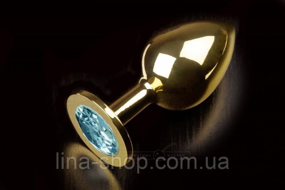 Большая золотистая анальная пробка с кристаллом (голубой)