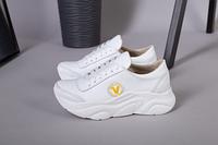 Кроссовки для девочки кожаные белые с желтым значком