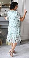 Елегантне жіноче сукню виконано з летить шифоновою тканини