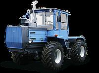 ХТЗ-150К-09-25 с машиной для резки мерзлого грунта МРМГ