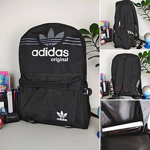 Подростковый городской рюкзакчерного цвета с брендовым логотипом