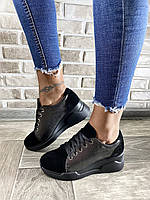Черные кожаные кроссовки на танкетке