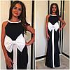 Черное платье с белыми вставками и крупным бантом