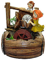 Фонтан мальчик с девочкой и мельницей