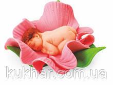 Немовля у квіточці (дівчинка)