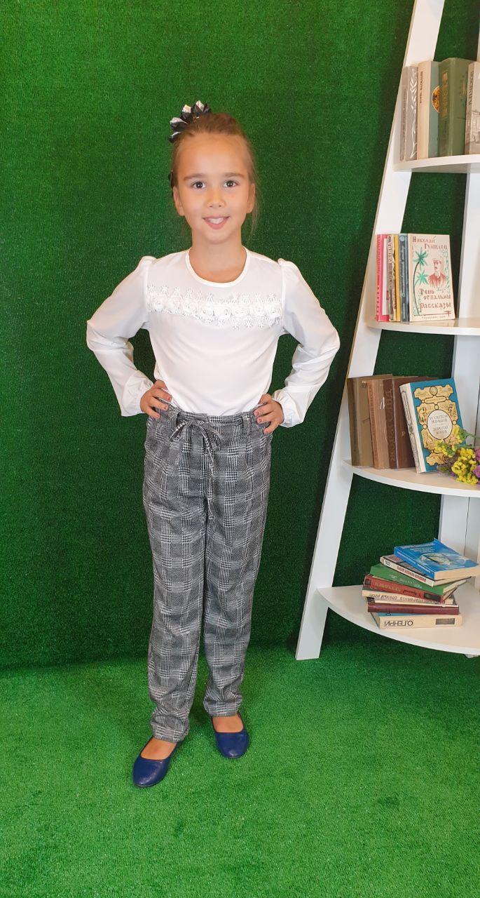 Сірі штани в клітинку для дівчинки на ріст 128,134,140,146,152