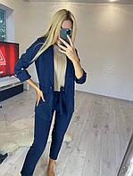 Деловой женский костюм пиджак и брюки