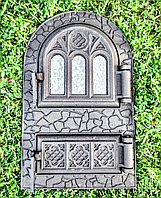 Двері зі склом спарена, подвійна, чавунна, аркової форми, пофарбована.