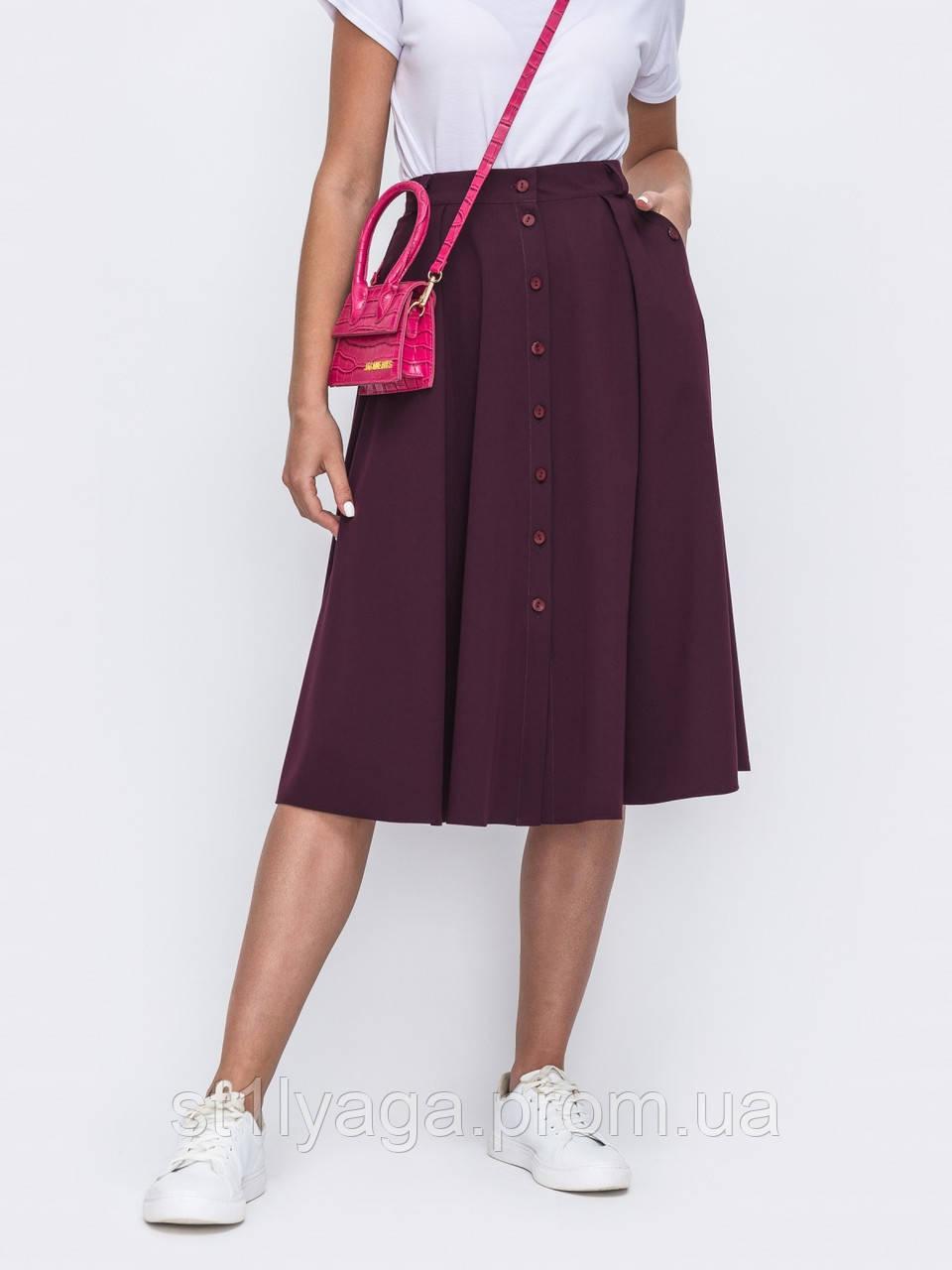 Расклешенная  юбка на застежке пуговицы