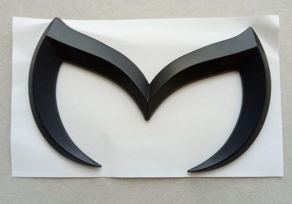 Эмблема Mazda черная