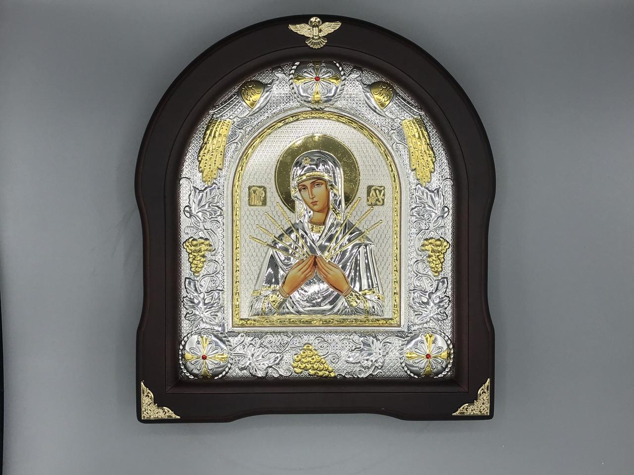 Икона мельхиоровая в деревянной рамке Семистрельная