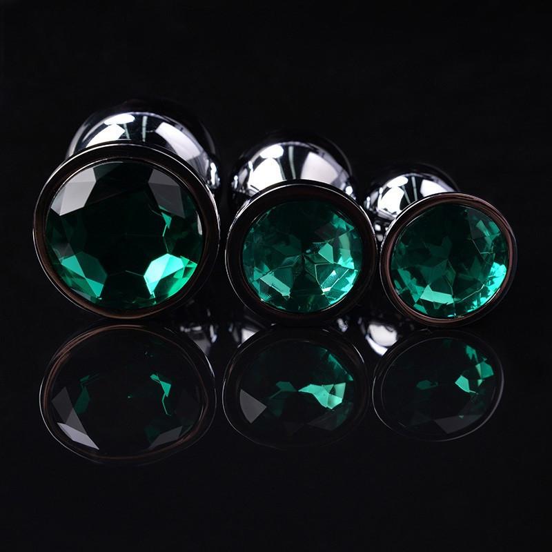 Набор металлических анальных пробок разного размера с зеленым кристаллом S M L