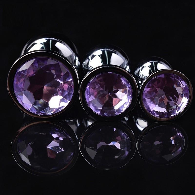 Набор металлических анальных пробок разного размера с сиреневым кристаллом S M L