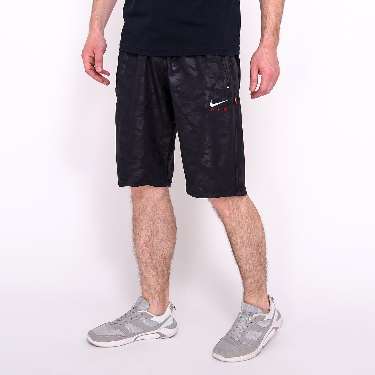 Чоловічі спортивні шорти Nike, синього кольору (плащівка, принт камуфляж).