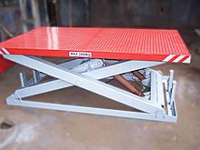 Підйомний стіл для розвантаження вантажівки. Платформа 2,5х2м. В/п 2т.