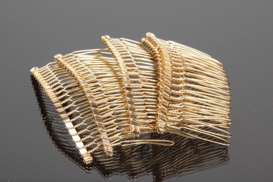 Гребень металлический на 20 зубчиков  7,5 на 3,7 см Цвет золотой Цена 6 грн.