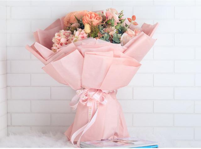 Як упакувати квіти в крафт папір