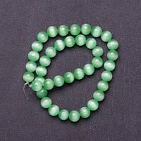 Бусины натуральный камень на нитке кошачий глаз светло Зеленый d-10мм L-37см купить оптом в интернет магазине