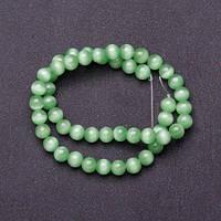 Бусины натуральный камень на нитке кошачий глаз светло Зеленый d-8мм L-37см купить оптом в интернет магазине