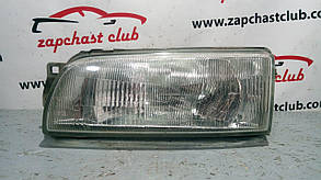 Фара левая Mitsubishi Lancer CB/CD, Libero MB907213 992364 Mitsubishi