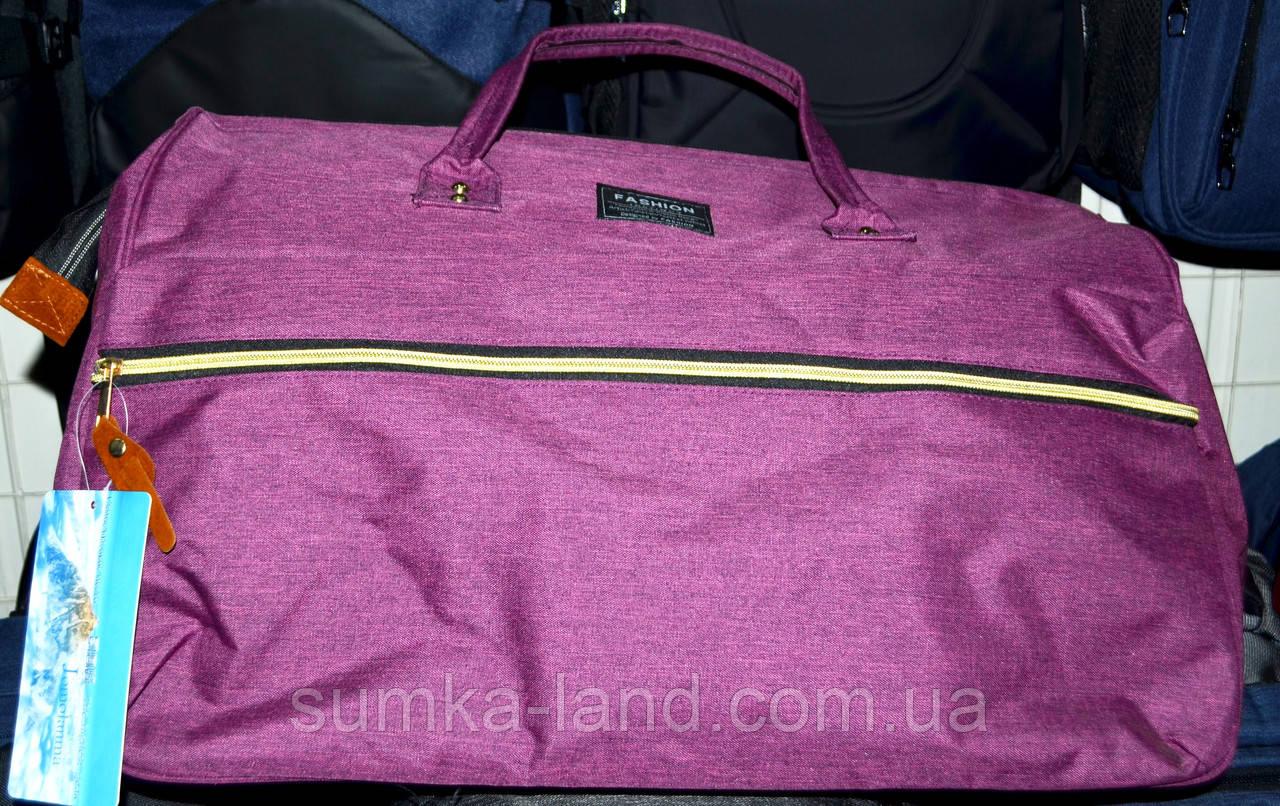 Жіноча фіолетова дорожня сумка на блискавці з двома ручками і ремінцем 50*30 см