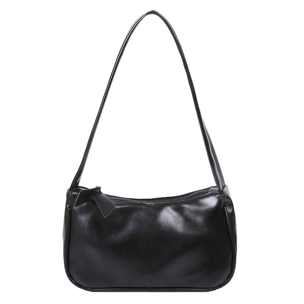 Женская сумочка лодочка в черном цвете