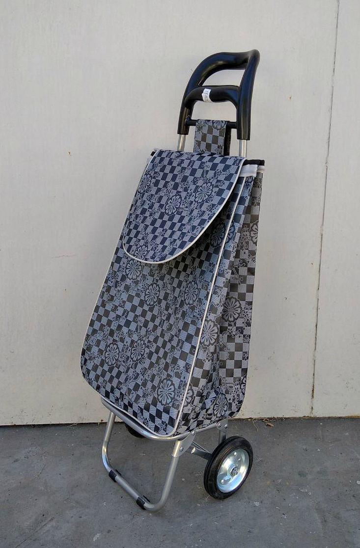 Хозяйственная сумка из плотной ткани - тележка с железными колесами и цельнометаллическим каркасом.