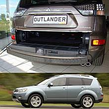 Mitsubishi Outlander XL 2006-2012 пластикова захисна накладка заднього бампера