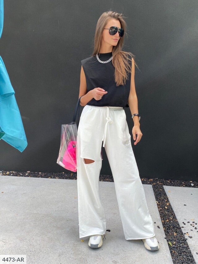 Стильные женские брюки-трубы в спортивном стиле с необработанными краями