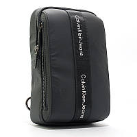 Рюкзак мужской Calvin Klein черный текстильный на одно плечо банан слинг, фото 1